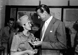 Photo of Gary Cooper signing an autograph