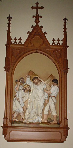 Simon of Cyrene - The fifth Station of the Cross, showing Simon of Cyrene helping Christ carry his cross. St. Raphael's Cathedral, Dubuque, Iowa.