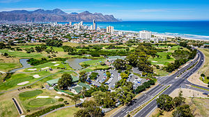 Strand, Western Cape - An aerial view of Strand with the Coast Road and Strand Golf Club in the foreground.
