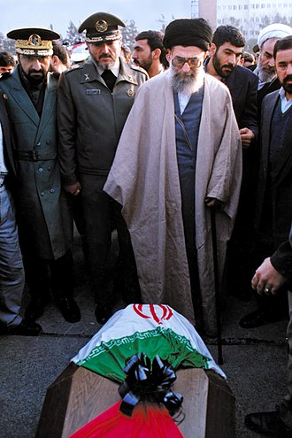 Mohsen Rezaee - Rezaee (first from left) with Supreme Leader Ali Khamenei in funeral of a commander of the Air Force, 8 January 1995.