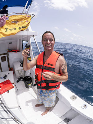 Pop-up satellite archival tag - Thomas Gray, CLS America, is holding a SeaTag-MOD pop-up satellite tag which is ready for deployment on a whale shark (Isla Mujeres, MX).