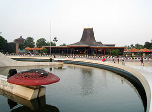 Javanisation - The Sasono Utomo main building in Taman Mini Indonesia Indah, featuring Javanese joglo architecture, stands in front of alun-alun Pancasila. The park was built by Tien Suharto, former first lady and wife of Suharto.