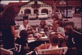 TOURISTS EAT AT OUTDOOR FACILITIES AT THE WURST HAUS IN HELEN GEORGIA, NEAR ROBERTSTOWN. NEW DEVELOPMENT AND A SURGE... - NARA - 557664.tif