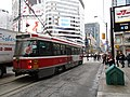 TTC streetcar visible by Dundas Square, 2015 12 01 (1) (23112168849).jpg