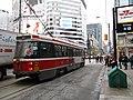 TTC streetcar visible by Dundas Square, 2015 12 01 (1) (23112168849).jpg