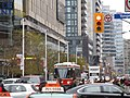 TTC streetcar visible by Dundas Square, 2015 12 01 (16) (23371154882).jpg