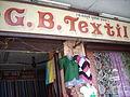 Textile shop in Mapusa market, Goa, India.JPG