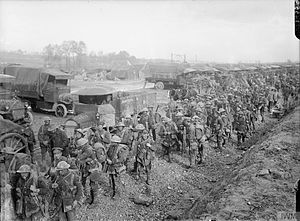 88th Brigade (United Kingdom) - Men of the 4th Battalion, Worcestershire Regiment gather near Army Service Corps (ASC) lorries after returning from the trenches near Albert, France, September 1916.