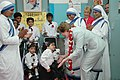 The First lady of USA, Ms. Laura Bush interacting with the disabled children on her visit to Mother Teresa Light of Life Home (Jeevan Jyothi) for disabled children, in New Delhi on March 2, 2006.jpg