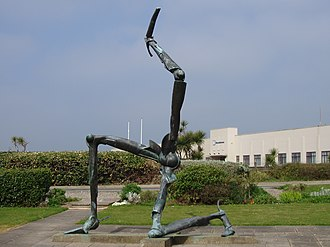 "Isle of Man Airport - Sculpture by Bryan Kneale called ""The Legs of Man"" at the terminal entrance."