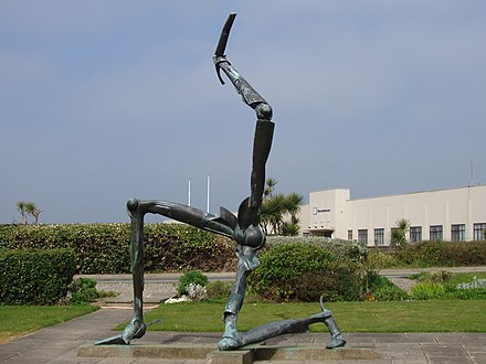 A sculpture of the Manx triskelion in front of Ronaldsway Airport terminal The Legs of Man - Isle of Man Triskelion - kingsley - 19-APR-09.jpg