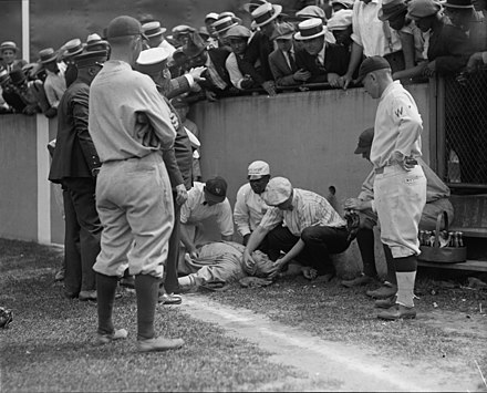 Ruth after losing consciousness from running into the wall at Griffith Stadium during a game against the Washington Senators on July 5, 1924. Ruth insisted on staying in the game, despite evident pain and a bruised pelvic bone, and hit a double in his next at-bat. Note the absence of a warning track along the outfield wall. The Library of Congress - Ruth knocked out (LOC).jpg