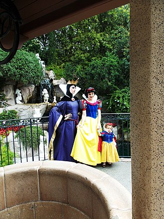 Snow White and the Seven Dwarfs (1937 film) - At Disneyland, Snow White and the Evil Queen take a photo with a visitor in 2012.