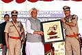 The Union Home Minister, Shri Rajnath Singh releasing the Coffee Table Book, during the 49th Raising Day Parade of the Central Industrial Security Force (CISF), in Ghaziabad on March 10, 2018.jpg