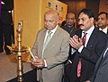 The Union Power Minister, Shri Sushil Kumar Shinde lighting the lamp to inaugurate the National Energy Conservation Day Function, in New Delhi on December 14, 2010.jpg