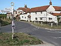 The Wiveton Bell pub and signpost - geograph.org.uk - 1514915.jpg
