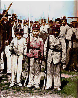 Child soldiers in Panama during the civil war of 1895. Child soldiers figured prominently in all of Colombia's civil wars during the 19th century, including the Thousand Days. Thousand Days War.jpg
