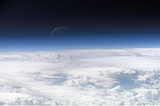 Aerospace - View of the Earth's atmosphere and the Moon beyond
