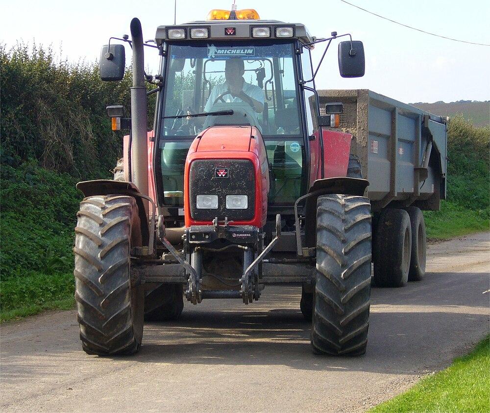 Massey Ferguson MF 6290 tractor towing a grain trailer