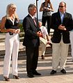 Tracy Mattes, Prince Albert II of Monaco and UIPM President Schormann wait for athletes to reach the finish line of the World Biathle Championships in Monte Carlo.jpg