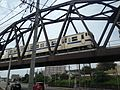 Train on bridge of Kashii Line on Japan National Route 495.jpg