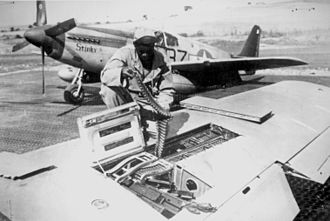 99th Flying Training Squadron - 99th Fighter Squadron mechanic reloading a P-51 Mustang, during World War II.