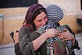 Two YPJ fighters give each other hugs.jpg