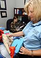 U.S. Air Force 2nd Lt. Stephanie Lutz, a deputy sexual assault response coordinator, left, and Ms 071126-F-BD983-001.jpg