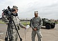 U.S. Air Force Senior Master Sgt. Kevin Tucker, left, interviews Tech. Sgt. Isaac Richardson, both with the 137th Air Refueling Wing, Oklahoma Air National Guard, while providing gate security at Briarwood 130528-Z-TK779-021.jpg