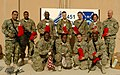 U.S. Airmen with the 451st Air Expeditionary Wing pose at Kandahar Airfield, Afghanistan, Dec. 4, 2013, with stockings they received from a charity 131204-F-XI929-281.jpg