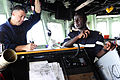 U.S. Coast Guard Chief Maritime Enforcement Specialist Rob Wills, left, with the Maritime Security Response Team, and Senegalese navy Ensign Alimamy Bassene, an assistant deployable team leader, conduct an alpha 120627-N-GN377-034.jpg