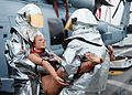 U.S. Navy Chief Fire Controlman Daniel Najera, left, and Hull Maintenance Technician 1st Class Jaime Martinez, both assigned to the littoral combat ship USS Freedom (LCS 1), rescue a simulated casualty during 130523-N-PD773-044.jpg