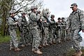 U.S. Soldiers await further instructions before participating in a day course land navigation skills while competing for the Expert Field Medical Badge at Joint Base Lewis-McChord, Wash., April 10, 2013 130410-A-FS521-185.jpg