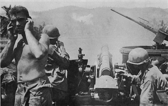 A US 105 mm (4.1 in) howitzer cannon of M7 Priest fires at Catmon Hill U.S. howitzer fires at Catmon Hill.jpg