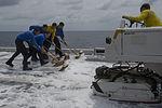 USS America deck scrubbing 140911-N-MZ309-025.jpg