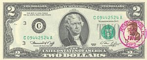 United States two-dollar bill - Series 1976 first day of issue $2 bill with a canceled JFK postage stamp.
