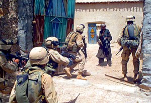 1st Battalion, 6th Marines - U.S. Marines from Alpha Co., Battalion Landing Team 1st Bn., 6th Marines, startle the owner of a compound who refused to open his door for a search during Operation EL DORADO 2004.