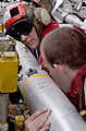 US Navy 030321-N-4308O-025 Aviation Ordnancemen work together to stage ordnance in the 'bomb farm' aboard USS Harry S. Truman (CVN 75).jpg