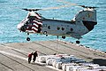 US Navy 030328-N-5292M-024 Sailors assigned to Weapon's department attach a pendant to a CH-46 Sea Knight assigned to Helicopter Combat Support Squadron Eleven Detachment Five (HC-11 Det. 5).jpg
