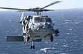 """US Navy 030430-N-9319H-001 An SH-60 Sea Dragon assigned to the """"Indians"""" of Helicopter Anti-Submarine Squadron Six (HS-6) transfers supplies from USS Bridge (AOE 10) to USS Nimitz (CVN 68).jpg"""