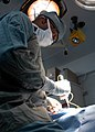 US Navy 040422-N-9273C-018 Lt. Cmdr. Hassan Tetteh, Ship's Surgeon aboard USS Carl Vision (CVN 70), performs a hernia repair operation.jpg
