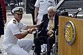 US Navy 040930-N-0295M-003 Cmdr. Michael Hegarty shakes the hand of Former Secretary of the Navy Paul H. Nitze, after he was presented a Bronze Star at a ceremony held at the U.S. Navy Memorial in Washington, D.C.jpg