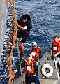US Navy 041102-N-9392E-004 Culinary Specialist 3rd Class Otis Salmo of Hawaii, climbs down a Jacob's Ladder from USS Blue Ridge (LCC 19).jpg