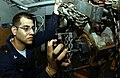 US Navy 050713-N-0413R-018 Aviation Support Equipment Technician 3rd Class Oscar Ochoa of Miami, Fla., assembles the motor gear on a pneumatic hoist.jpg