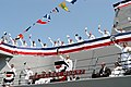 """US Navy 050730-N-3672K-340 Sailors stationed aboard the Navy's newest Arleigh Burke-class destroyer, USS Halsey (DDG 97) give a """"Hip! Hip! Hooray!"""" as they bring the ship to life during the ship's commissioning ceremony.jpg"""