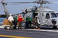 US Navy 050905-N-2389S-043 Air Department personnel load Meals Ready-to-Eat (MREs) onto an HH-60H Seahawk helicopter on the flight deck aboard the Nimitz-class aircraft carrier USS Harry S. Truman (CVN 75).jpg