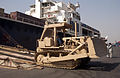 US Navy 051017-N-9288T-053 A heavy-duty bulldozer rolls-off the roll-on-roll-off ship SS Northern Lights during an offload of U.S. Army military vehicles while pierside in Karachi, Pakistan.jpg