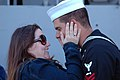 US Navy 070313-N-4047W-148 Torpedoman's Mate 2nd Class Tyson Hinkley is greeted by his wife during the homecoming of guided missile cruiser USS Bunker Hill (CG 52).jpg