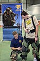 US Navy 070630-N-8110K-014 Senior Chief Explosive Ordnance Disposal Technician David Prasek demonstrates the proper way to wear a Med-Eng EOD 8 Bomb Suit to a participant of the Navy SEAL Trident Challenge at Boston University.jpg