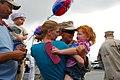 US Navy 070811-N-7918H-408 Storekeeper Seaman Apprentice Jennifer Faulkner is greets her family after returning to Naval Station.jpg